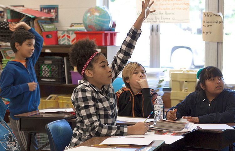 Student raises her hand during a math lesson at Sedgefield Elementary.